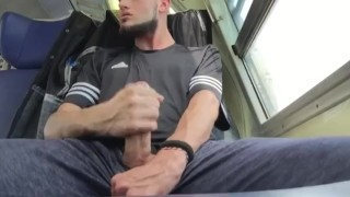 Straight guy Jerking his cock and cumming on the train