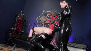 Elbow Deep Double Fisting & Strap-On for Mistress' Rubber Whipping Slave