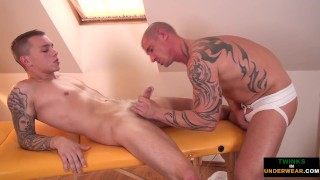 Massaged twink gets a naughty blowjob